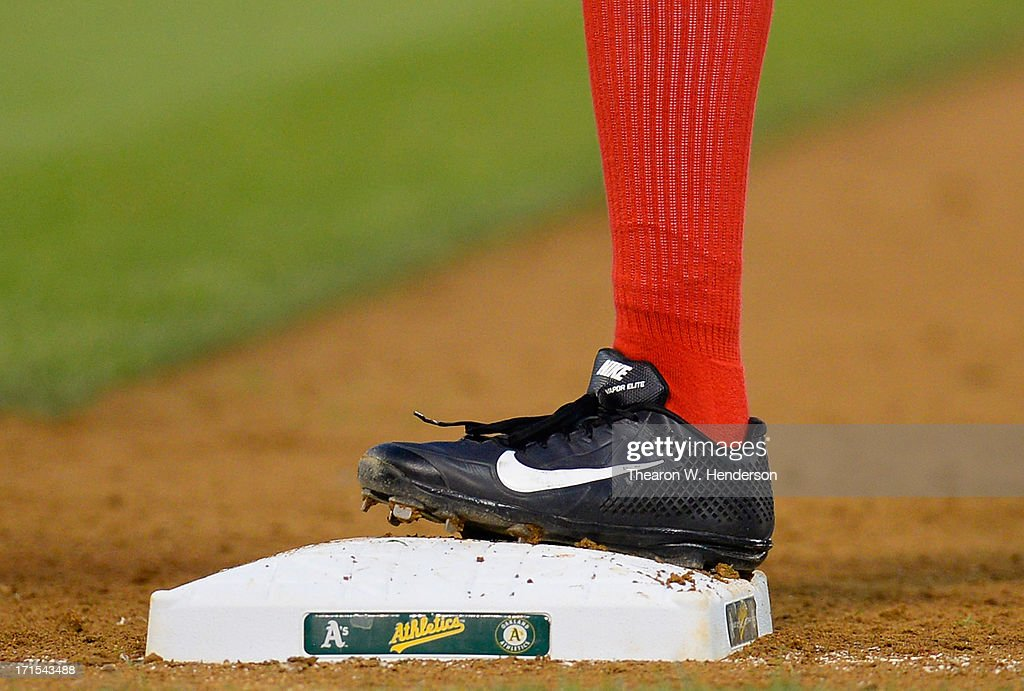 Derrick Robinson #15 of the Cincinnati Reds wearing Nike baseball cleats stands on first base against the Oakland Athletics at O.co Coliseum on June 25, 2013 in Oakland, California.