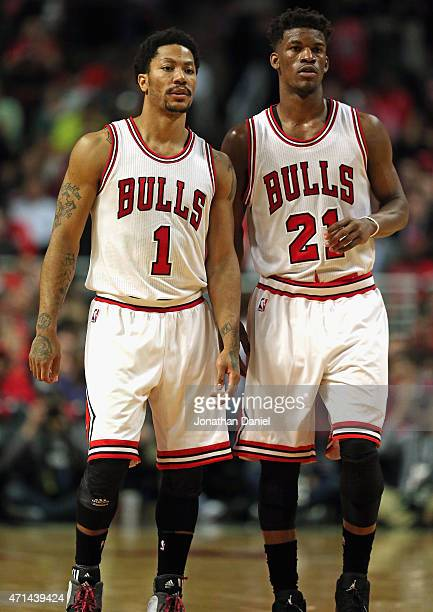 Derrick Rose and Jimmy Butler of the Chicago Bulls wait for a member of the Milwaukee Bucks to shoot a free throw during the first round of the 2015...