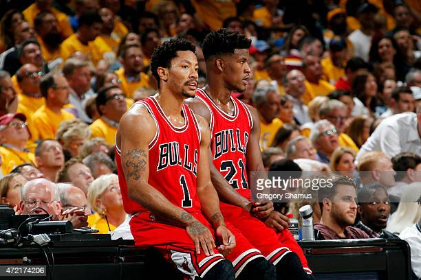 Derrick Rose and Jimmy Butler of the Chicago Bulls wait to check into the game against the Cleveland Cavaliers in Game One of the Eastern Conference...