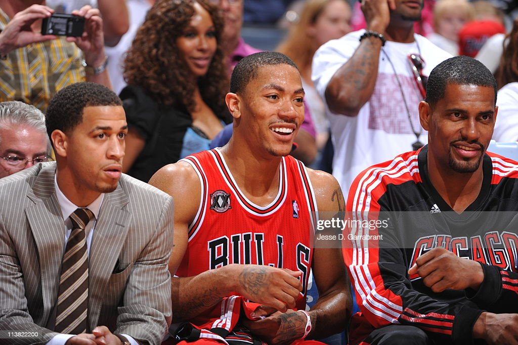Derrick Rose #1 and Kurt Thomas #40 of the Chicago Bulls share a laugh while taking a break against the Atlanta Hawks in Game Three of the Eastern Conference Semifinals in the 2011 NBA Playoffs on May 6, 2011 at the Phillips Arena in Atlanta, Georgia.