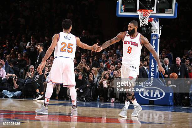 Derrick Rose and Kyle O'Quinn of the New York Knicks celebrate during a game against the Minnesota Timberwolves on December 2 2016 at Madison Square...