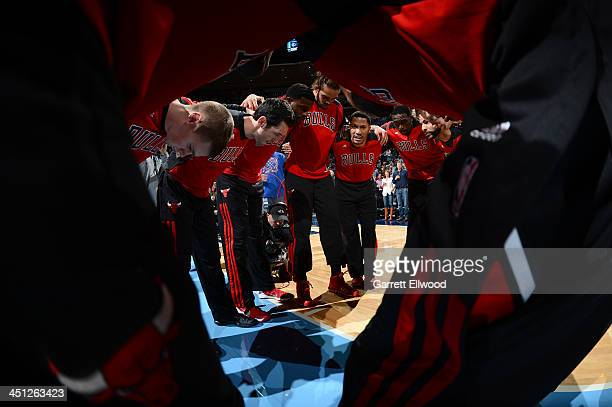 Derrick Rose and the Chicago Bulls huddle up before the game against the Denver Nuggets on November 21 2013 at the Pepsi Center in Denver Colorado...