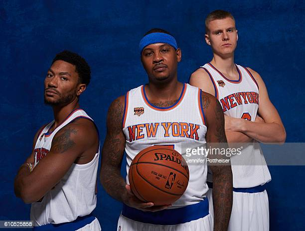 Derrick Rose Carmelo Anthony and Kristaps Porzingis of the New York Knicks pose for a portrait during media day at the Ritz Carlton in White Plains...