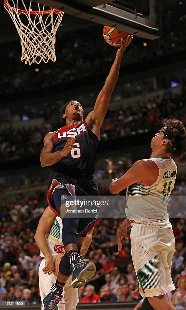 <a gi-track='captionPersonalityLinkClicked' href=/galleries/search?phrase=Derrick+Rose&family=editorial&specificpeople=4212732 ng-click='$event.stopPropagation()'>Derrick Rose</a> #6 of team USA drives to the basket over <a gi-track='captionPersonalityLinkClicked' href=/galleries/search?phrase=Anderson+Varejao&family=editorial&specificpeople=202247 ng-click='$event.stopPropagation()'>Anderson Varejao</a> #11 of team Brazil during an exhibition game at the United Center on August 16, 2014 in Chicago, Illinois. Team USA defeated team Brazil 95-78.