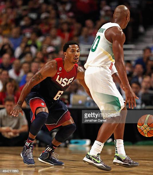 Derrick Rose of team USA guards Leandro Barbosa of team Brazil during an exhibition game at the United Center on August 16 2014 in Chicago Illinois...