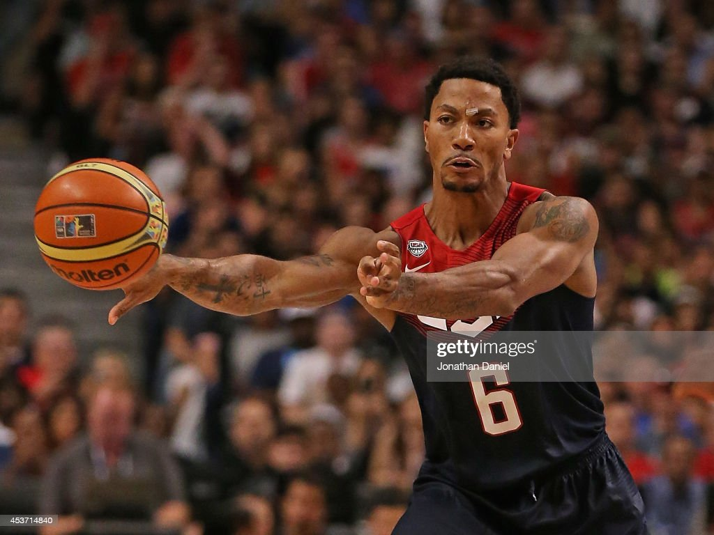 <a gi-track='captionPersonalityLinkClicked' href=/galleries/search?phrase=Derrick+Rose&family=editorial&specificpeople=4212732 ng-click='$event.stopPropagation()'>Derrick Rose</a> #6 of team USA passes against team Brazil during an exhibition game at the United Center on August 16, 2014 in Chicago, Illinois. Team USA defeated team Brazil 95-78.