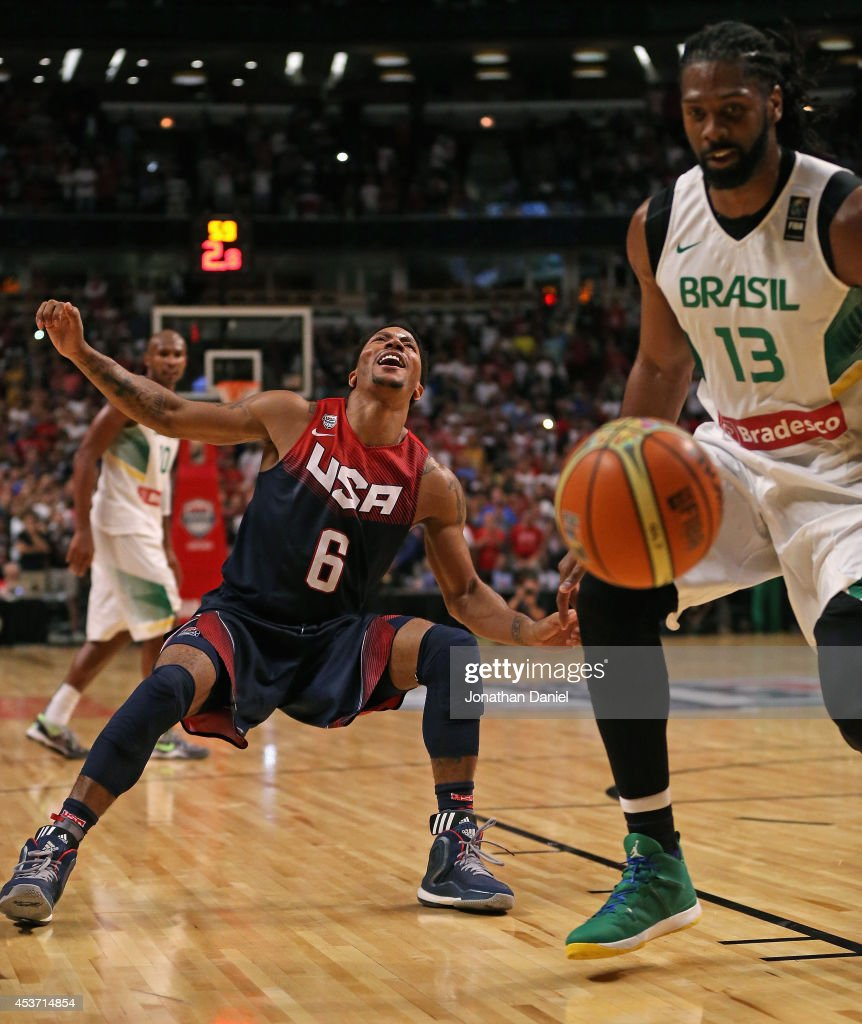 <a gi-track='captionPersonalityLinkClicked' href=/galleries/search?phrase=Derrick+Rose&family=editorial&specificpeople=4212732 ng-click='$event.stopPropagation()'>Derrick Rose</a> #6 of team USA reacts after losing control of the ball in the final seconds against <a gi-track='captionPersonalityLinkClicked' href=/galleries/search?phrase=Nene+Hilario+-+Basket&family=editorial&specificpeople=4250456 ng-click='$event.stopPropagation()'>Nene Hilario</a> #13 of team Brazil during an exhibition game at the United Center on August 16, 2014 in Chicago, Illinois. Team USA defeated team Brazil 95-78.