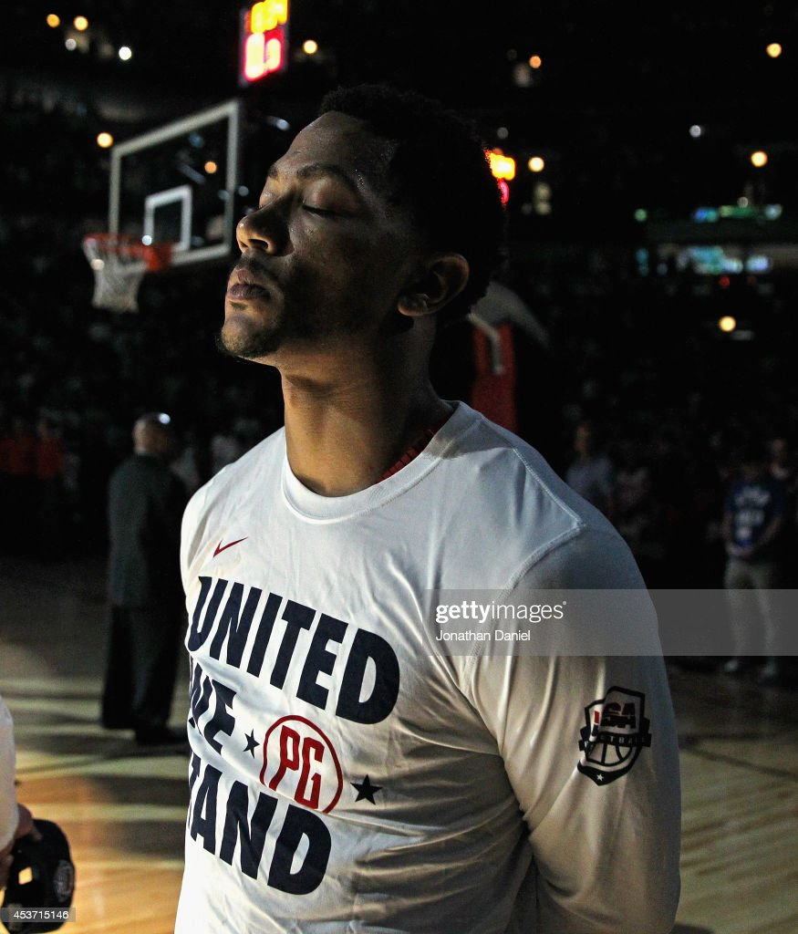 <a gi-track='captionPersonalityLinkClicked' href=/galleries/search?phrase=Derrick+Rose&family=editorial&specificpeople=4212732 ng-click='$event.stopPropagation()'>Derrick Rose</a> #6 of team USA stands during the National Anthem before an exhibition game against team Brazil at the United Center on August 16, 2014 in Chicago, Illinois. Team USA defeated team Brazil 95-78.