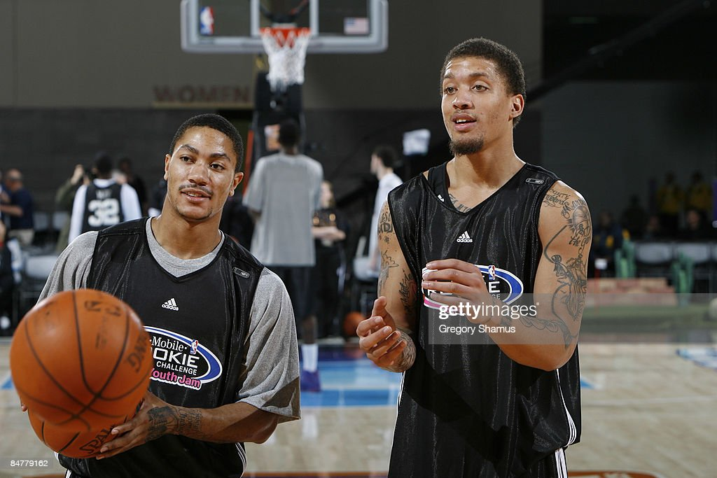 Derrick Rose of the Chicago Bulls and Michael Beasley of the Miami Heat watch during the Rookie/Sophomore practice on center court during NBA Jam...