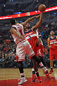Derrick Rose of the Chicago Bulls blocks a shot by John Wall of the Washington Wizards at the United Center on January 11 2016 in Chicago Illinois...