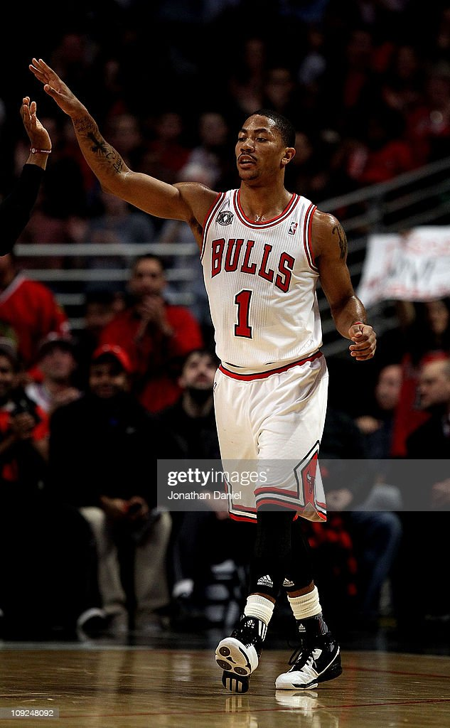 <a gi-track='captionPersonalityLinkClicked' href=/galleries/search?phrase=Derrick+Rose&family=editorial&specificpeople=4212732 ng-click='$event.stopPropagation()'>Derrick Rose</a> #1 of the Chicago Bulls celebrates with a teammate during a game against the San Antonio Spurs at the United Center on February 17, 2011 in Chicago, Illinois. The Bulls defeated the Spurs 109-99.
