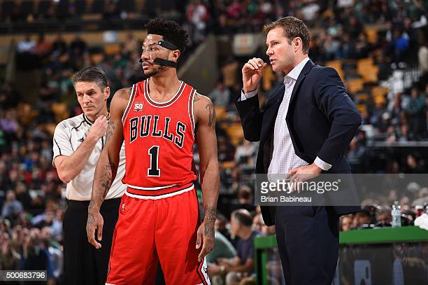 Derrick Rose of the Chicago Bulls discusses with Fred Hoiberg of the Chicago Bulls during the game against the Boston Celtics on December 9 2015 at...