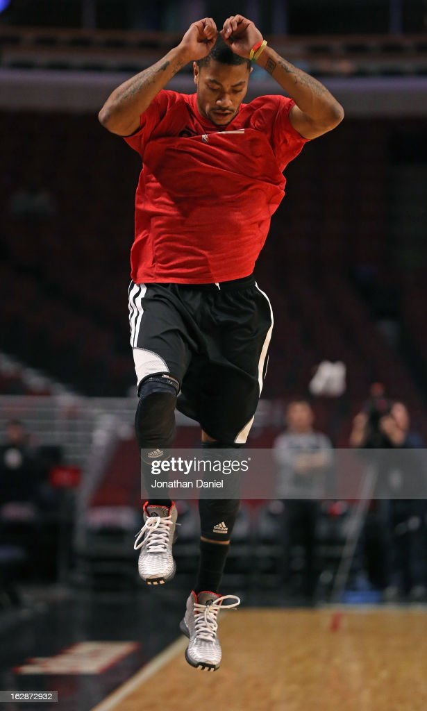 Derrick Rose #1 of the Chicago Bulls does a hopping drill while working out before the Bulls take on the Phildelphia 76ers at the United Center on February 28, 2013 in Chicago, Illinois.