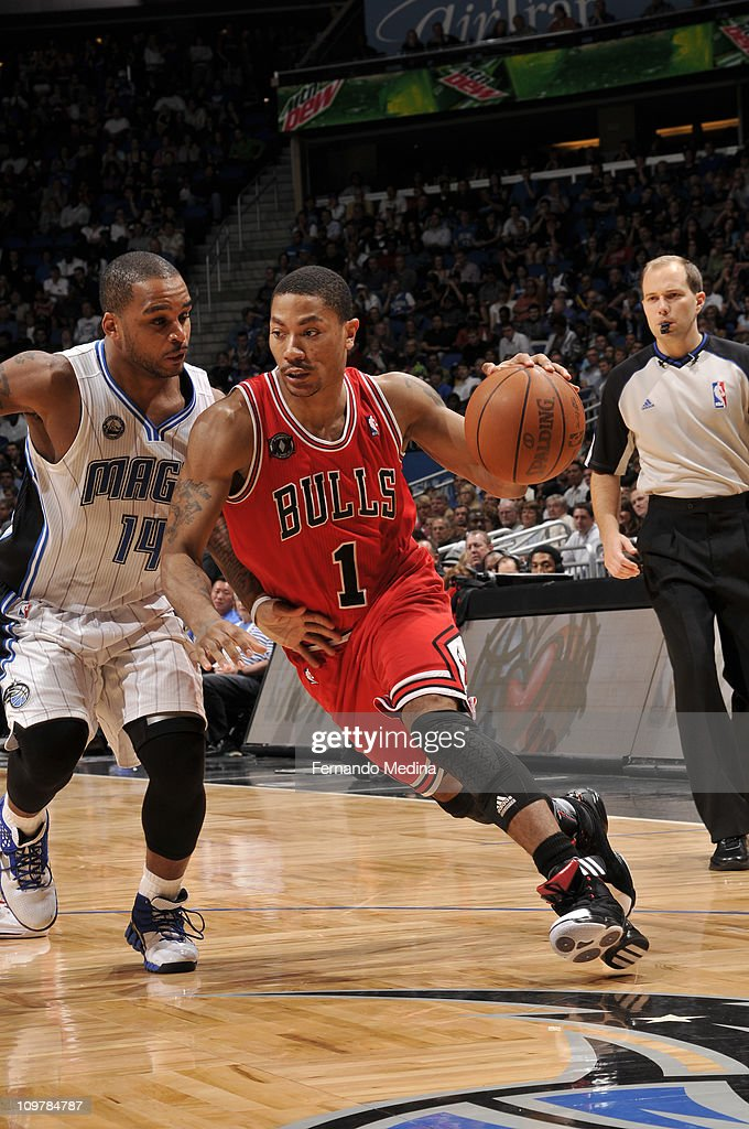 <a gi-track='captionPersonalityLinkClicked' href=/galleries/search?phrase=Derrick+Rose&family=editorial&specificpeople=4212732 ng-click='$event.stopPropagation()'>Derrick Rose</a> #1 of the Chicago Bulls drives against <a gi-track='captionPersonalityLinkClicked' href=/galleries/search?phrase=Jameer+Nelson&family=editorial&specificpeople=202057 ng-click='$event.stopPropagation()'>Jameer Nelson</a> #14 of the Orlando Magic on March 4, 2011 at the Amway Center in Orlando, Florida.