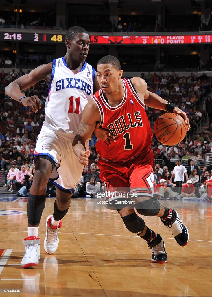 Derrick Rose #1 of the Chicago Bulls drives against Jrue Holiday #11 of the Philadelphia 76ers during the game on March 20, 2010 at the Wachovia Center in Philadelphia, Pennsylvania.