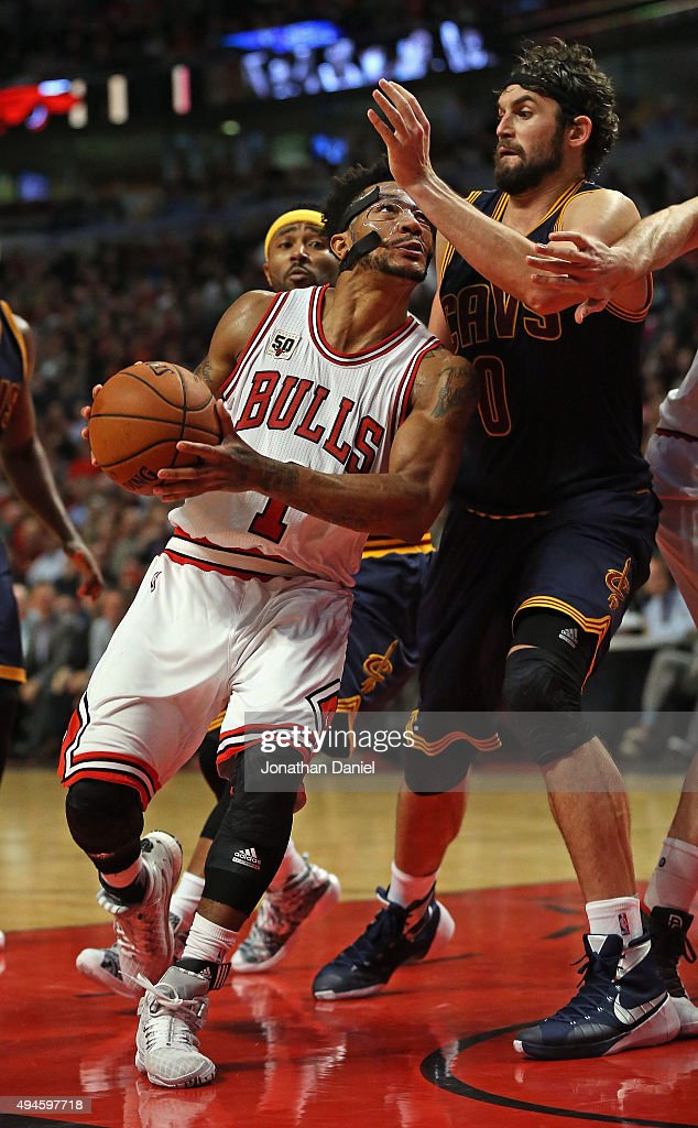 Derrick Rose #1 of the Chicago Bulls drives against Kevin Love #0 of the Cleveland Cavaliers during the season opening game at the United Center on October 27, 2015 in Chicago, Illinois. The Bulls defeated the Cavaliers 97-95. Note to User: User expressly acknowledges and agrees that, by downloading and or using the photograph, User is consenting to the terms and conditions of the Getty Images License Agreement.