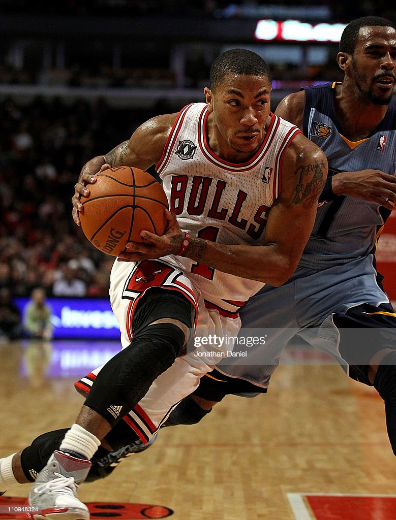 Derrick Rose #1 of the Chicago Bulls drives against Mike Conley #11 of the Memphis Grizzlies at the United Center on March 25, 2011 in Chicago, Illinois. The Bulls defeated the Grizzlies 99-96.