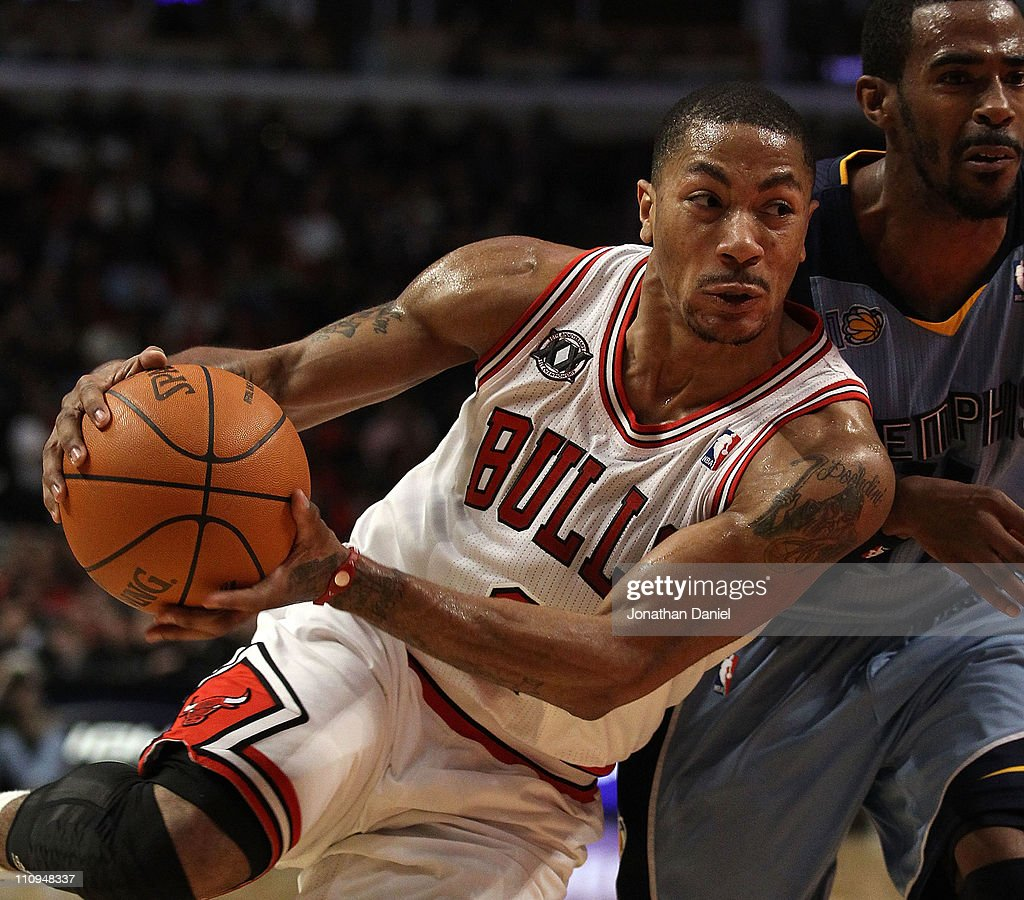 <a gi-track='captionPersonalityLinkClicked' href=/galleries/search?phrase=Derrick+Rose&family=editorial&specificpeople=4212732 ng-click='$event.stopPropagation()'>Derrick Rose</a> #1 of the Chicago Bulls drives against Mike Conley #11 of the Memphis Grizzlies at the United Center on March 25, 2011 in Chicago, Illinois. The Bulls defeated the Grizzlies 99-96.