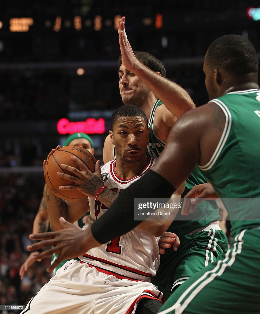 <a gi-track='captionPersonalityLinkClicked' href=/galleries/search?phrase=Derrick+Rose&family=editorial&specificpeople=4212732 ng-click='$event.stopPropagation()'>Derrick Rose</a> #1 of the Chicago Bulls drives against <a gi-track='captionPersonalityLinkClicked' href=/galleries/search?phrase=Nenad+Krstic&family=editorial&specificpeople=202625 ng-click='$event.stopPropagation()'>Nenad Krstic</a> #4 and <a gi-track='captionPersonalityLinkClicked' href=/galleries/search?phrase=Glen+Davis+-+Basketball+Player&family=editorial&specificpeople=709385 ng-click='$event.stopPropagation()'>Glen Davis</a> #11 of the Boston Celtics at United Center on April 7, 2011 in Chicago, Illinois. The Bulls defeated the Celtics 97-81.