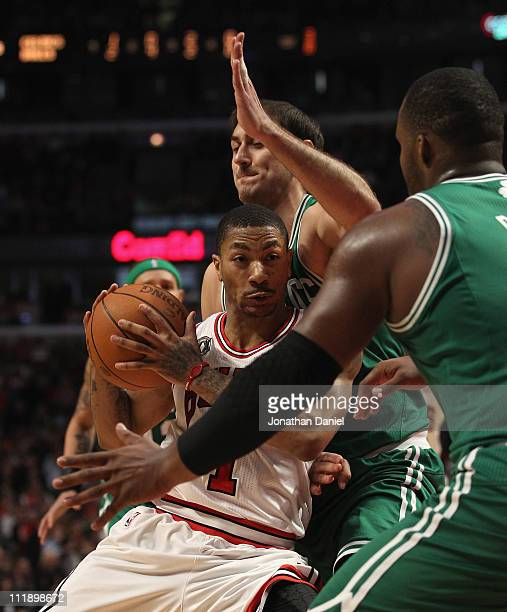 Derrick Rose of the Chicago Bulls drives against Nenad Krstic and Glen Davis of the Boston Celtics at United Center on April 7 2011 in Chicago...