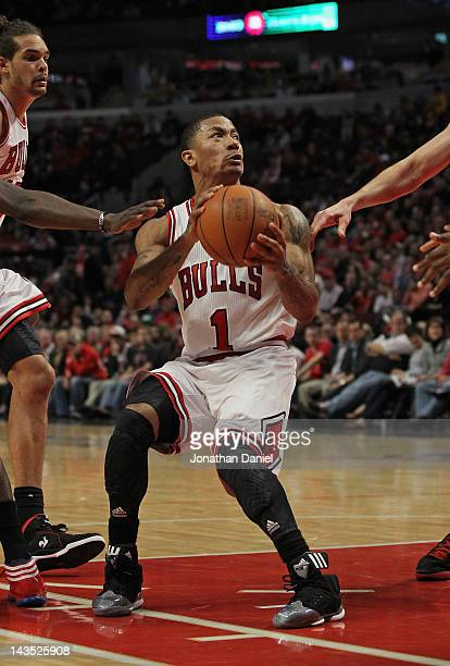 Derrick Rose of the Chicago Bulls drives against the Philadelphia 76ers and appears to injure his knee in Game One of the Eastern Conference...