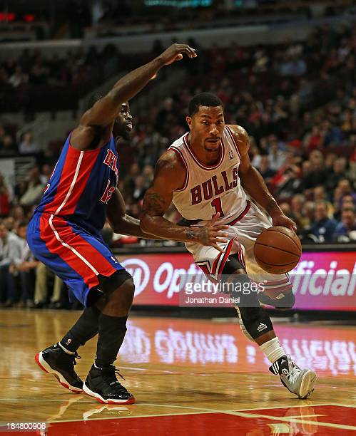 Derrick Rose of the Chicago Bulls drives against Will Bynum of the Detroit Pistons during a preseason game at the United Center on October 16 2013 in...