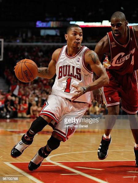 Derrick Rose of the Chicago Bulls drives around Antawn Jamison of the Cleveland Cavaliers in Game Four of the Eastern Conference Quarterfinals during...