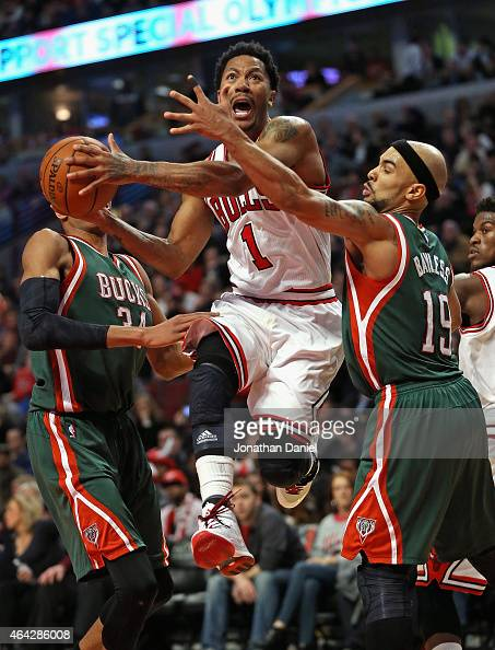 Derrick Rose of the Chicago Bulls drives between Giannis Antetokounmpo and Jerryd Bayless of the Milwaukee Bucks at the United Center on February 23...