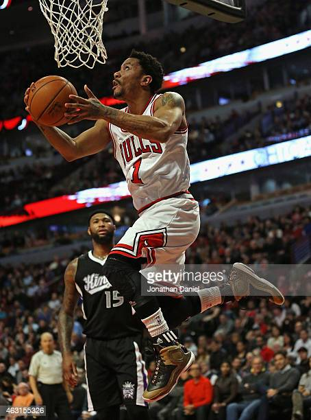 Derrick Rose of the Chicago Bulls drives in for a reverse layup against the Sacramento Kings at United Center on February 10 2015 in Chicago Illinois...
