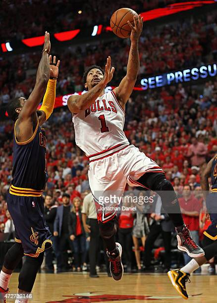 Derrick Rose of the Chicago Bulls drives past Kyrie Irving of the Cleveland Cavaliers on his way to a gamehigh 30 points in Game Three of the Eastern...