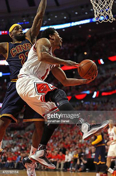 Derrick Rose of the Chicago Bulls drives past LeBron James of the Cleveland Cavaliers in Game Three of the Eastern Conference Semifinals of the 2015...