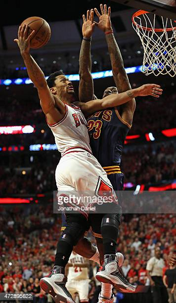 Derrick Rose of the Chicago Bulls drives to the basket against LeBron James of the Cleveland Cavaliers in Game Four of the Eastern Conference...