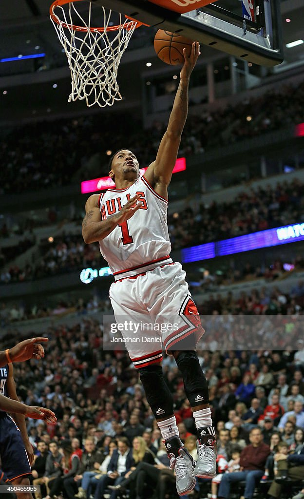<a gi-track='captionPersonalityLinkClicked' href=/galleries/search?phrase=Derrick+Rose&family=editorial&specificpeople=4212732 ng-click='$event.stopPropagation()'>Derrick Rose</a> #1 of the Chicago Bulls drives to the basket against the Charlotte Bobcats at the United Center on November 18, 2013 in Chicago, Illinois. The Bulls defeated the Bobcats 86-81.