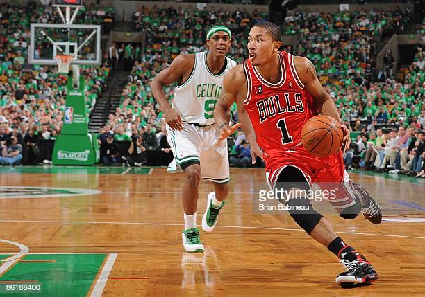 Derrick Rose of the Chicago Bulls drives to the basket around Rajon Rondo of the Boston Celtics in Game One of the Eastern Conference Quarterfinals...