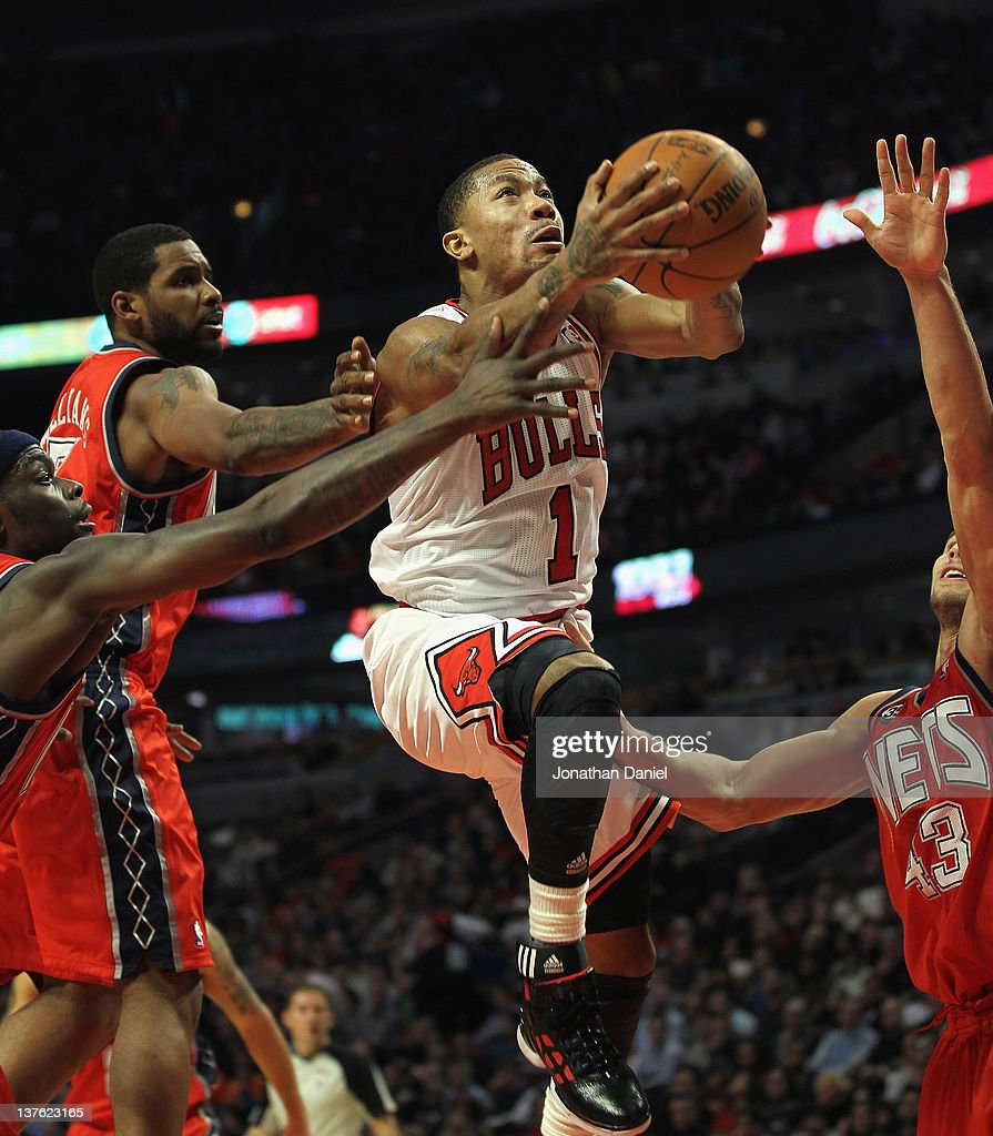 <a gi-track='captionPersonalityLinkClicked' href=/galleries/search?phrase=Derrick+Rose&family=editorial&specificpeople=4212732 ng-click='$event.stopPropagation()'>Derrick Rose</a> #1 of the Chicago Bulls drives to the basket between (L-R) <a gi-track='captionPersonalityLinkClicked' href=/galleries/search?phrase=Anthony+Morrow&family=editorial&specificpeople=814354 ng-click='$event.stopPropagation()'>Anthony Morrow</a> #22, <a gi-track='captionPersonalityLinkClicked' href=/galleries/search?phrase=Shawne+Williams&family=editorial&specificpeople=728608 ng-click='$event.stopPropagation()'>Shawne Williams</a> #7 and <a gi-track='captionPersonalityLinkClicked' href=/galleries/search?phrase=Kris+Humphries&family=editorial&specificpeople=209199 ng-click='$event.stopPropagation()'>Kris Humphries</a> #43 of the New Jersey Nets at the United Center on January 23, 2012 in Chicago, Illinois. The Bulls defeated the Nets 110-95.