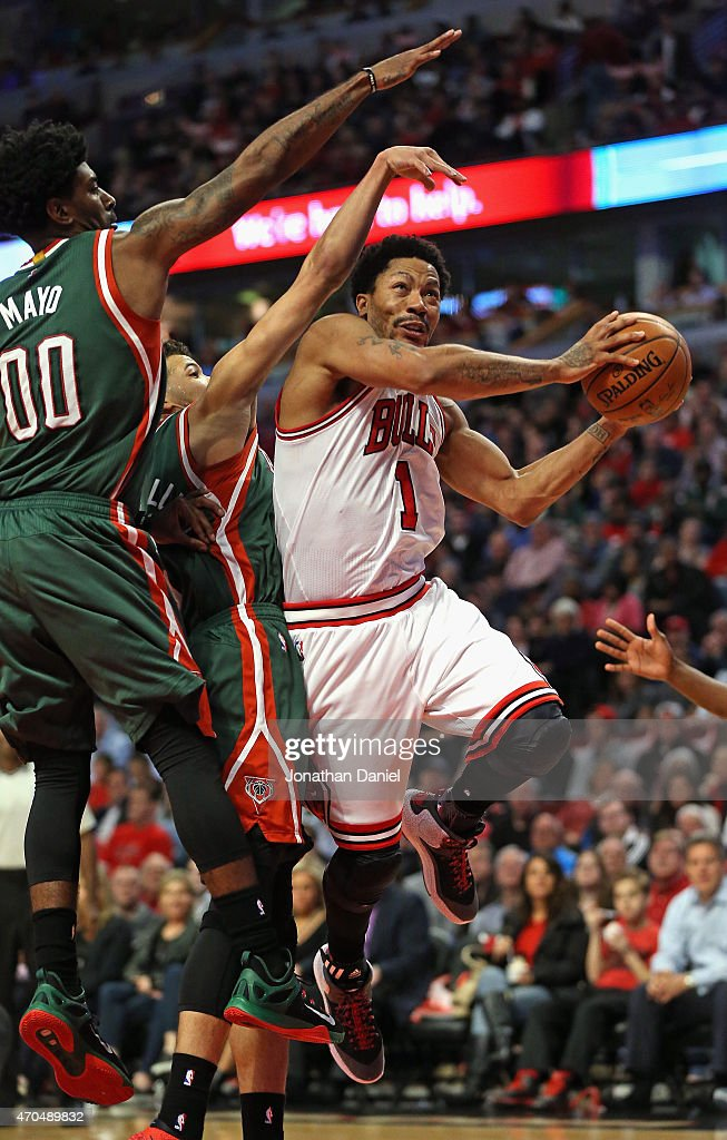 Derrick Rose #1 of the Chicago Bulls drives to the basket pagainst O.J. Mayo #00 and Michael Carter-Williams #5 of the Milwaukee Bucks during the first round of the 2015 NBA Playoffs at the United Center on April 20, 2015 in Chicago, Illinois. The Bulls defeated the Bucks 91-82.