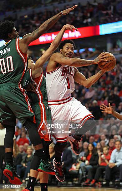 Derrick Rose of the Chicago Bulls drives to the basket pagainst OJ Mayo and Michael CarterWilliams of the Milwaukee Bucks during the first round of...