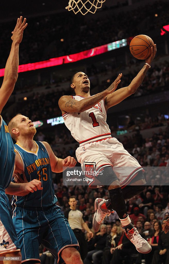 <a gi-track='captionPersonalityLinkClicked' href=/galleries/search?phrase=Derrick+Rose&family=editorial&specificpeople=4212732 ng-click='$event.stopPropagation()'>Derrick Rose</a> #1 of the Chicago Bulls drives to the basket past <a gi-track='captionPersonalityLinkClicked' href=/galleries/search?phrase=Chris+Kaman&family=editorial&specificpeople=201661 ng-click='$event.stopPropagation()'>Chris Kaman</a> #35 of the New Orleans Hornets on his way to a game-high 32 points at the United Center on February 28, 2012 in Chicago, Illinois. The Bulls defeated the Hornets 99-95.