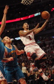 Derrick Rose of the Chicago Bulls drives to the basket past Chris Kaman of the New Orleans Hornets on his way to a gamehigh 32 points at the United...
