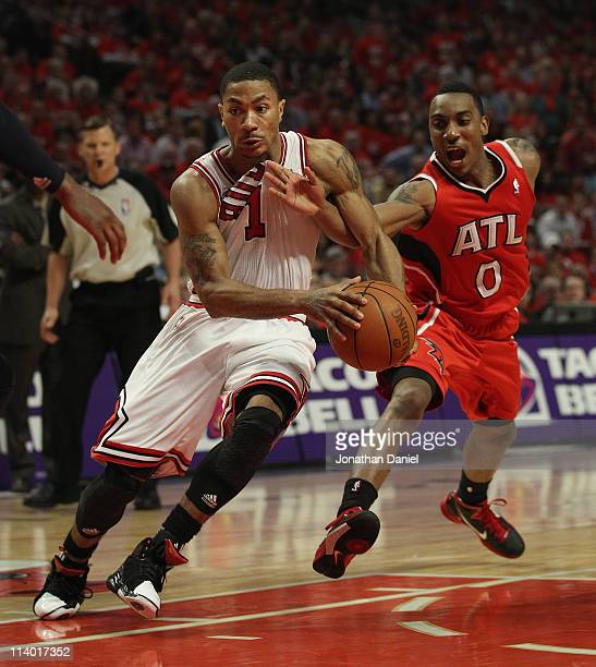 Derrick Rose of the Chicago Bulls drives to the basket under pressure from Jeff Teague of the Atlanta Hawks in Game Five of the Eastern Conference...