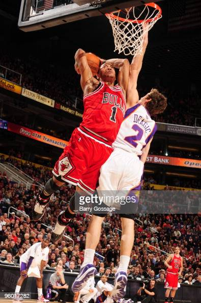 Derrick Rose of the Chicago Bulls dunks against Goran Dragic of the Phoenix Suns in an NBA Game played on January 22 2010 at US Airways Center in...