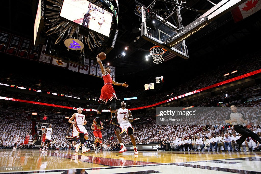 Derrick Rose #1 of the Chicago Bulls dunks against LeBron James #6 and Mike Bibby #0 of the Miami Heat in Game Four of the Eastern Conference Finals during the 2011 NBA Playoffs on May 24, 2011 at American Airlines Arena in Miami, Florida.