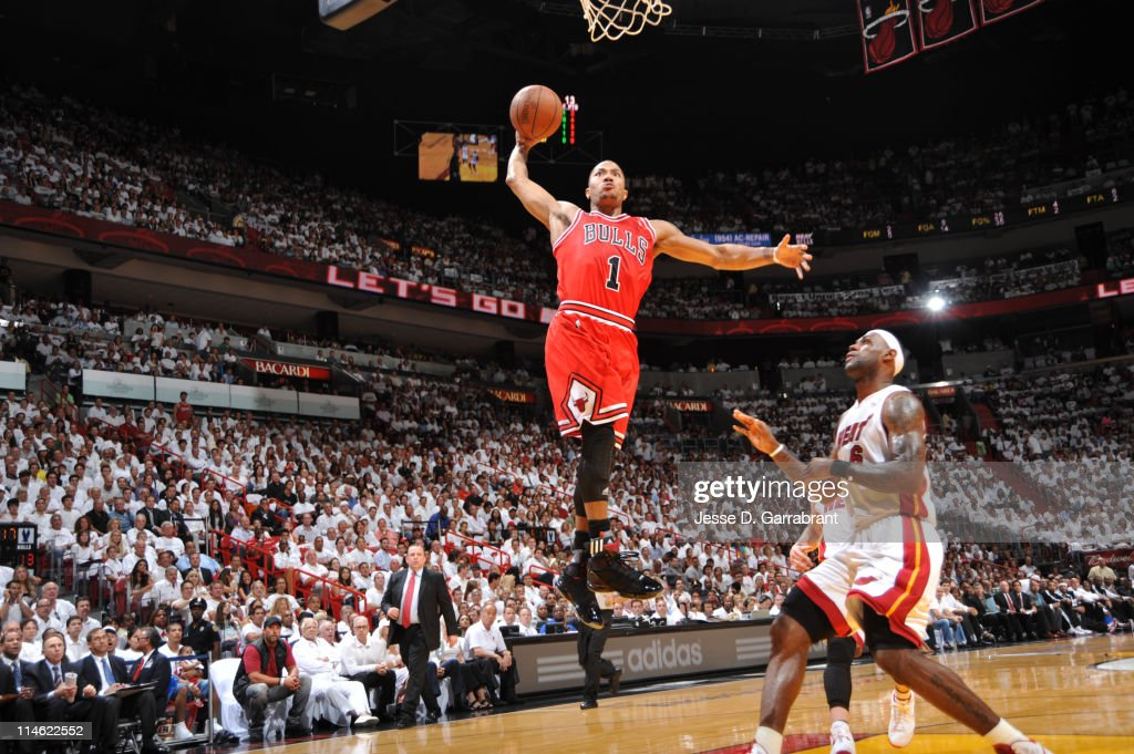 Derrick Rose #1 of the Chicago Bulls dunks against LeBron James #6 of the Miami Heat during Game Four of the Eastern Conference Finals in the 2011 NBA Playoffs on May 24, 2011 at the American Airlines Arena in Miami, Florida.