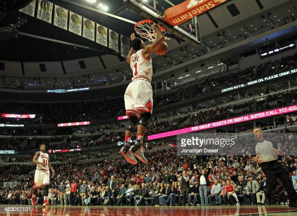 Derrick Rose of the Chicago Bulls dunks against the Utah Jazz at the United Center on November 8 2013 in Chicago Illinois The Bulls defeated the Jazz...