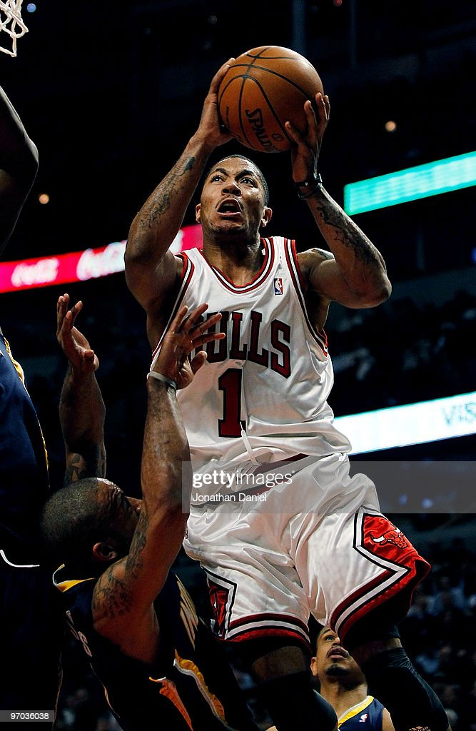 <a gi-track='captionPersonalityLinkClicked' href=/galleries/search?phrase=Derrick+Rose&family=editorial&specificpeople=4212732 ng-click='$event.stopPropagation()'>Derrick Rose</a> #1 of the Chicago Bulls gets called for a charge against <a gi-track='captionPersonalityLinkClicked' href=/galleries/search?phrase=Dahntay+Jones&family=editorial&specificpeople=202206 ng-click='$event.stopPropagation()'>Dahntay Jones</a> #1 of the Indiana Pacers at the United Center on February 24, 2010 in Chicago, Illinois. The Bulls defeated the Pacers 120-110.