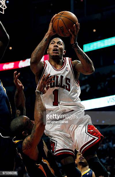 Derrick Rose of the Chicago Bulls gets called for a charge against Dahntay Jones of the Indiana Pacers at the United Center on February 24 2010 in...