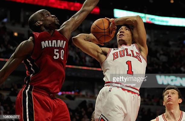 Derrick Rose of the Chicago Bulls gets off a shot as he is fouled by Joel Anthony of the Miami Heat at the United Center on January 15 2011 in...