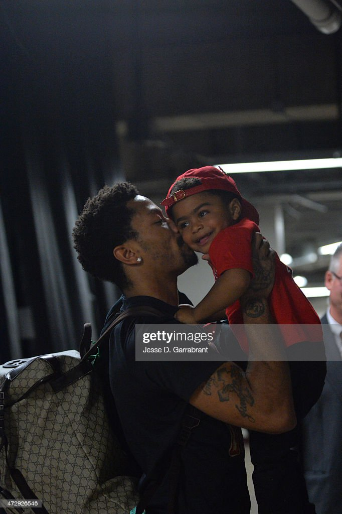 Derrick Rose #1 of the Chicago Bulls gives his son P.J. a kiss after hitting the game winning shot against the Cleveland Cavaliers at the United Center During Game Three of the Eastern Conference Semifinals during the 2015 NBA Playoffs on May 8, 2015 in Chicago,Illinois