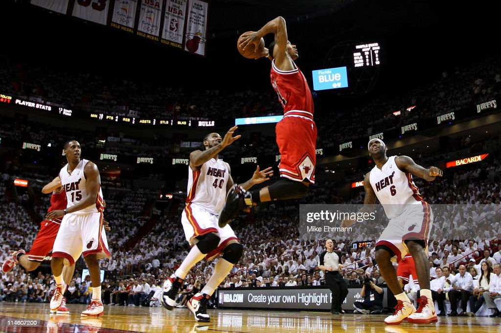 Derrick Rose of the Chicago Bulls goes up for a dunk against Mario Chalmers Udonis Haslem and LeBron James of the Miami Heat in the first half of...