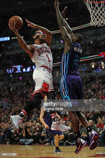 Derrick Rose of the Chicago Bulls goes up for a shot against Marvin Williams of the Charlotte Hornets at the United Center on December 5 2015 in...